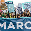 Protesters gather with signs at March for Science