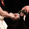 Up-close shot of couple holding hands during wedding ceremony