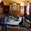 Chris Berlin, second from right, leads a group meditation in Emerson Chapel.