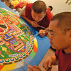 In 2008, Geshe Kalsang and Venerable Phuntsok sifted colored sand to create a mandala of compassion.