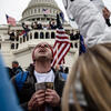 A man prays in front of the United States Capitol during on January 6, 2021. Photo by Getty Images