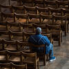 Man sits alone in church sanctuary / Photo: Catholic Church of England and Wales