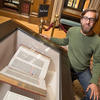 HDS graduating student Walter Smelt with a Gutenberg Bible