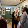 photo of Margot Gil and Tarana Burke in hallway