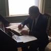 Rector Alexandrov signs the university guest book