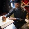 Vice President Osinbajo signs the university guest book