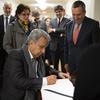 President Moreno signs the university guest book at Massachusetts Hall