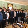 South Korean medical professionals with the University Marshal in the Wadsworth House parlor