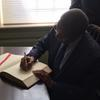 President Kikwete signs the university guest book