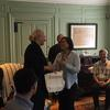 Margot Gill accepting a gift from the United Board Fellows