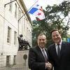 President Bacow with President Varela with the flag of Panama
