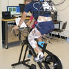 Cyclists on bicycle ergometer at Simon Fraser University courtesy of Adrian Lai