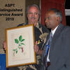 Dr. Kanchi Gandhi (right) is presented with the award by Dr. Warren L. Wagner, Chair of Botany at the Smithsonian National Museum of Natural History.