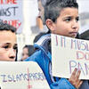 Children holding signs against Islamophobia