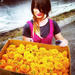 Anne Eder with tray of marigolds.